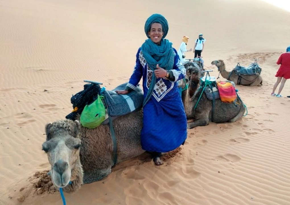 man with the camel in a Zagora tour from Marrakech